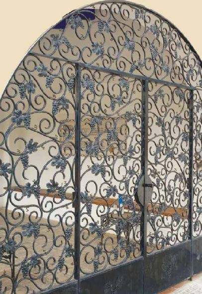Old gates in handmade and ornamental wrought iron